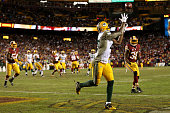 Wide receiver Davante Adams of the Green Bay Packers scores a secondquarter touchdown past free safety Dashon Goldson of the Washington Redskins...