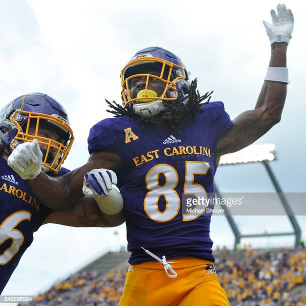 Wide receiver Davon Grayson of the East Carolina Pirates celebrates his touchdown reception against the Virginia Tech Hokies in the first half at...