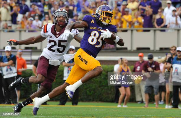 Wide receiver Davon Grayson of the East Carolina Pirates scores a touchdown while being defended by cornerback Greg Stroman of the Virginia Tech...