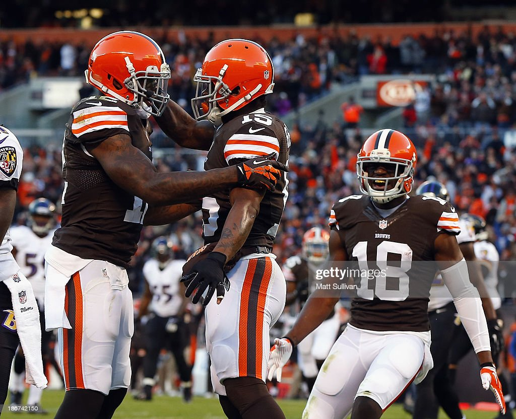 Wide receiver Davone Bess #15 of the Cleveland Browns celebrates after scoring a touchdown with teammates Josh Gordon #12 and Greg Little #18 against the Baltimore Ravens at FirstEnergy Stadium on November 3, 2013 in Cleveland, Ohio.