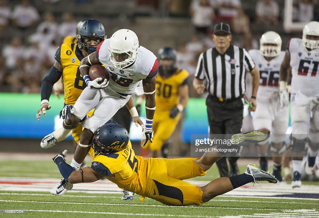 Wide receiver <a gi-track='captionPersonalityLinkClicked' href=/galleries/search?phrase=Davonte%27+Neal&family=editorial&specificpeople=9725369 ng-click='$event.stopPropagation()'>Davonte' Neal</a> #19 of the Arizona Wildcats holds on to the catch while being tackled by safety Michael Lowe #5 of the California Golden Bears at Arizona Stadium on September 20, 2014 in Tucson, Arizona.