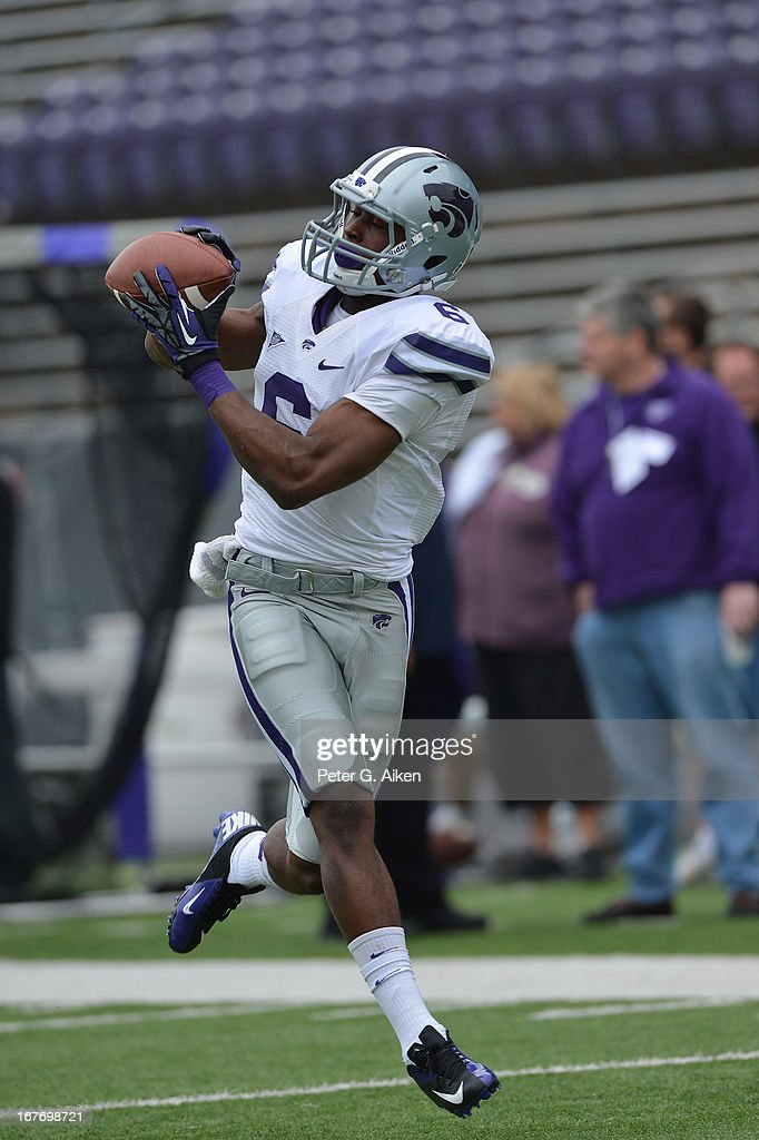 Wide receiver Deante Burton #6 of the Kansas State Wildcats catches a pass before the Purple and White Spring Game on April 27, 2013 at Bill Snyder Family Stadium in Manhattan, Kansas.