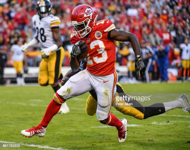 Wide receiver De'Anthony Thomas of the Kansas City Chiefs breaks through the tackle attempt of defensive back Mike Hilton of the Pittsburgh Steelers...