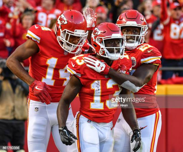 Wide receiver De'Anthony Thomas of the Kansas City Chiefs celebrates a touchdown with teammate Demarcus Robinson during the fourth quarter of the...