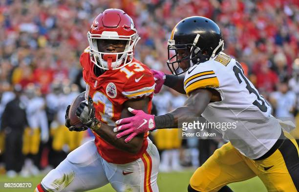 Wide receiver De'Anthony Thomas of the Kansas City Chiefs runs up field against defensive back Mike Hilton of the Pittsburgh Steelers during the...