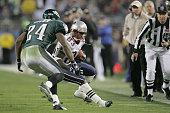 Wide receiver Deion Branch of the New England Patriots catches a pass and runs against the defense of Sheldon Brown of the Philadelphia Eagles during...