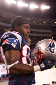 Wide receiver Deion Branch of the New England Patriots looks on from the sidelines during the AFC Divisional Playoff Game against the Denver Broncos...