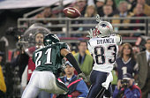 Wide receiver Deion Branch of the New England Patriots receives a pass over Matt Ware of the Philadelphia Eagles during Super Bowl XXXIX at Alltel...