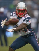 Wide receiver Deion Branch of the New England Patriots warms up prior to the game against the Seattle Seahawks at CenturyLink Field on October 14...