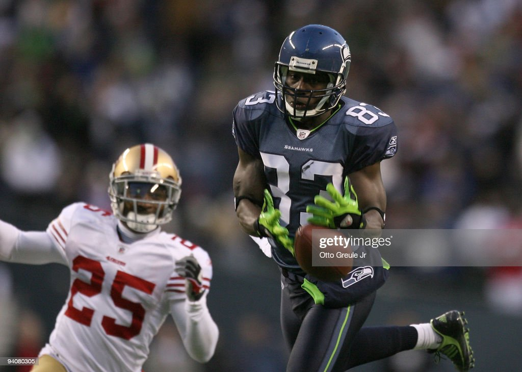 Wide receiver <a gi-track='captionPersonalityLinkClicked' href=/galleries/search?phrase=Deion+Branch&family=editorial&specificpeople=206261 ng-click='$event.stopPropagation()'>Deion Branch</a> #83 of the Seattle Seahawks just misses making a catch in the fourth quarter against Tarell Brown #25 the San Francisco 49ers on December 6, 2009 at Qwest Field in Seattle, Washington. The Seahawks defeated the 49ers 20-17.