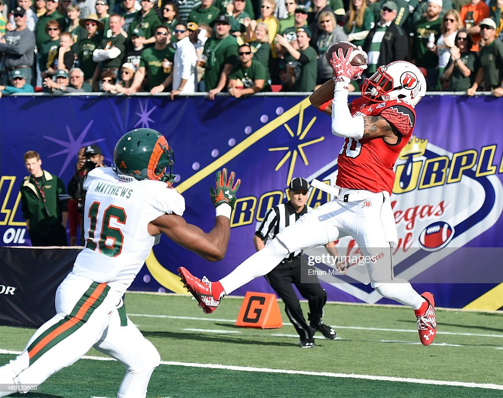 Wide receiver Delshawn McClellon of the Utah Utes catches a touchdown pass in the end zone against safety Trent Matthews of the Colorado State Rams...