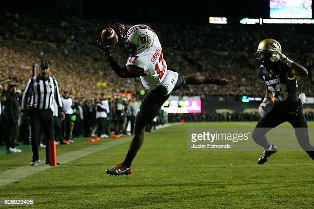 Wide receiver Demari Simpkins of the Utah Utes catches a pass for a touchdown while being defended by defensive back Ahkello Witherspoon of the...