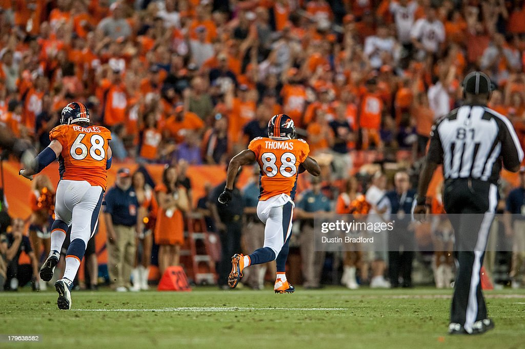 Wide receiver <a gi-track='captionPersonalityLinkClicked' href=/galleries/search?phrase=Demaryius+Thomas&family=editorial&specificpeople=4536795 ng-click='$event.stopPropagation()'>Demaryius Thomas</a> #88 of Denver Broncos has a long touchdown run after the catch in the fourth quarter of a game against the Baltimore Ravens during the game at Sports Authority Field at Mile High on September 5, 2013 in Denver Colorado.