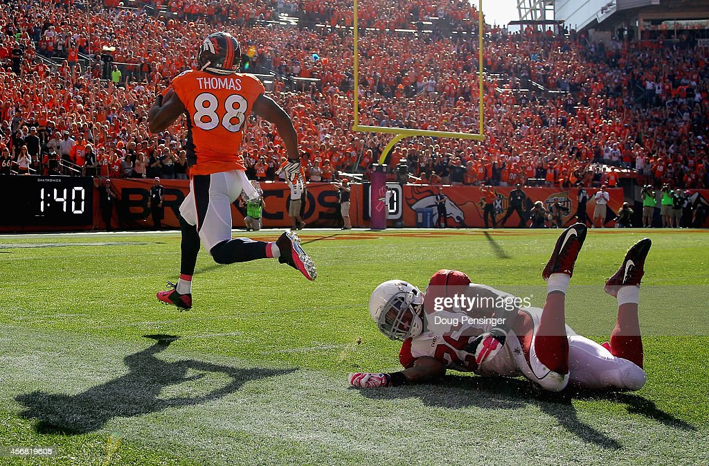 Wide receiver <a gi-track='captionPersonalityLinkClicked' href=/galleries/search?phrase=Demaryius+Thomas&family=editorial&specificpeople=4536795 ng-click='$event.stopPropagation()'>Demaryius Thomas</a> #88 of the Denver Broncos beats free safety <a gi-track='captionPersonalityLinkClicked' href=/galleries/search?phrase=Rashad+Johnson&family=editorial&specificpeople=3941326 ng-click='$event.stopPropagation()'>Rashad Johnson</a> #26 of the Arizona Cardinals for a 86 yard touchdown pass reception to take a 21-13 lead over the Arizona Cardinals in the second quarter at Sports Authority Field at Mile High on October 5, 2014 in Denver, Colorado. The Broncos defeated the Cardinals 41-20.