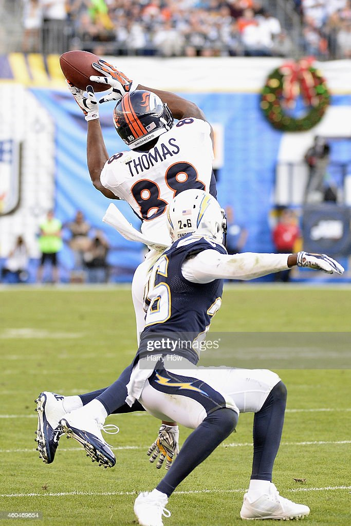 Wide receiver <a gi-track='captionPersonalityLinkClicked' href=/galleries/search?phrase=Demaryius+Thomas&family=editorial&specificpeople=4536795 ng-click='$event.stopPropagation()'>Demaryius Thomas</a> #88 of the Denver Broncos catches a 28-yard touchdown pass while defended by cornerback <a gi-track='captionPersonalityLinkClicked' href=/galleries/search?phrase=Brandon+Flowers+-+American+Football+Player&family=editorial&specificpeople=7270342 ng-click='$event.stopPropagation()'>Brandon Flowers</a> #26 of the San Diego Chargers at Qualcomm Stadium on December 14, 2014 in San Diego, California.