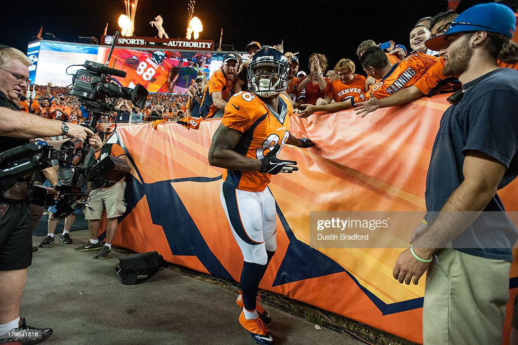 Wide receiver Demaryius Thomas #88 of the Denver Broncos celebrates a touchdown against the Baltimore Ravens during the game at Sports Authority Field at Mile High on September 5, 2013 in Denver Colorado.