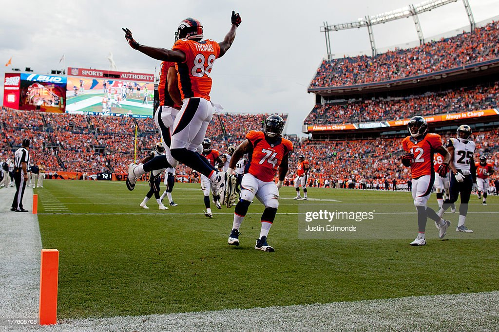 Wide receiver Demaryius Thomas #88 of the Denver Broncos celebrates his touchdown with wide receiver Eric Decker #87 during the first quarter against the St. Louis Rams at Sports Authority Field Field at Mile High on August 23, 2013 in Denver, Colorado.