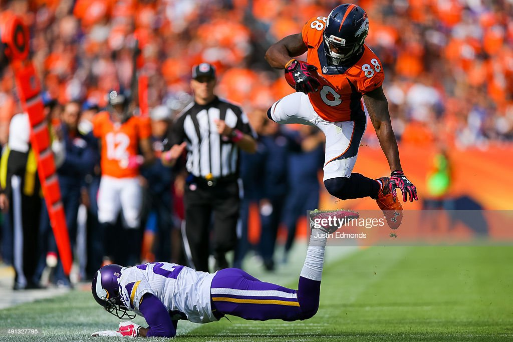 Wide receiver <a gi-track='captionPersonalityLinkClicked' href=/galleries/search?phrase=Demaryius+Thomas&family=editorial&specificpeople=4536795 ng-click='$event.stopPropagation()'>Demaryius Thomas</a> #88 of the Denver Broncos flies through the air after being hit by cornerback <a gi-track='captionPersonalityLinkClicked' href=/galleries/search?phrase=Terence+Newman&family=editorial&specificpeople=220965 ng-click='$event.stopPropagation()'>Terence Newman</a> #23 of the Minnesota Vikings on a 30 yard completion in the second quarter of a game at Sports Authority Field at Mile High on October 4, 2015 in Denver, Colorado.
