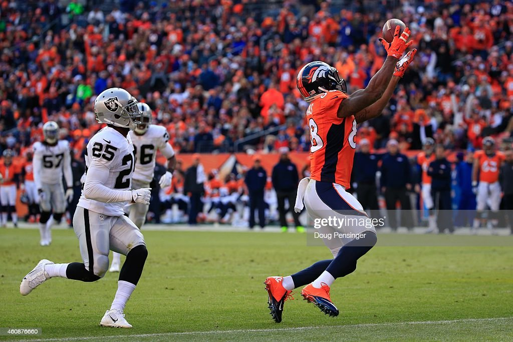 Wide receiver Demaryius Thomas of the Denver Broncos has a 23 yard reception before being tackled at the 1yard line by cornerback DJ Hayden of the...
