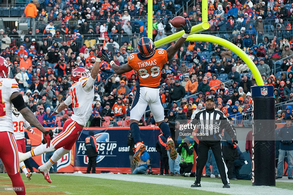 Wide receiver Demaryius Thomas #88 of the Denver Broncos hauls in an acrobatic touchdown reception under coverage by cornerback Javier Arenas #21 of the Kansas City Chiefs during a game at Sports Authority Field Field at Mile High on December 30, 2012 in Denver, Colorado. The Broncos defeated the Chiefs 38-3.