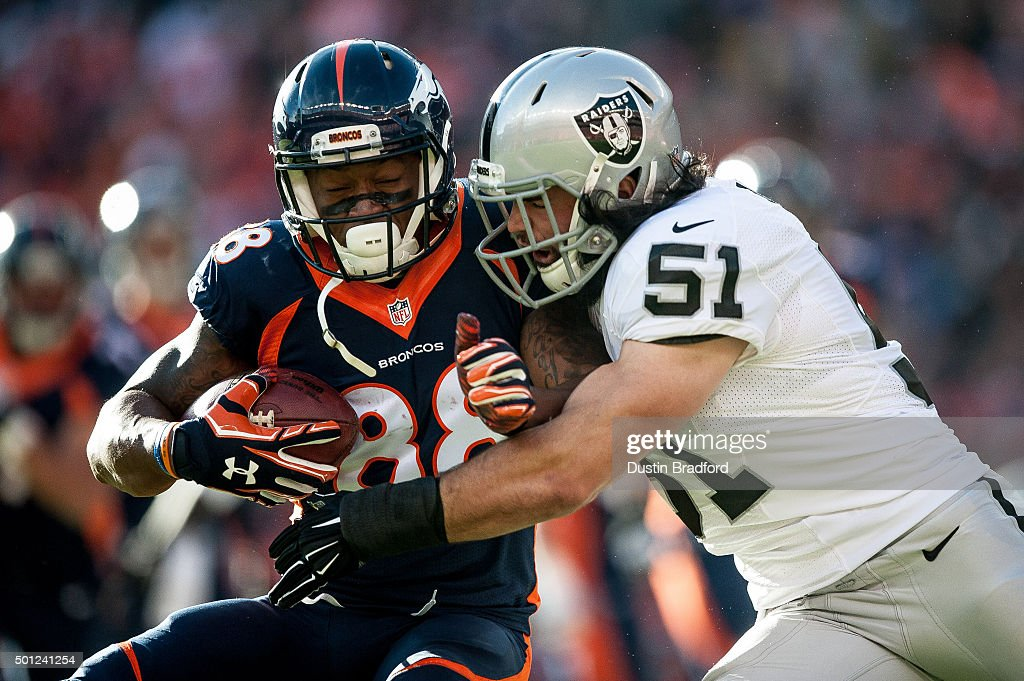 Wide receiver <a gi-track='captionPersonalityLinkClicked' href=/galleries/search?phrase=Demaryius+Thomas&family=editorial&specificpeople=4536795 ng-click='$event.stopPropagation()'>Demaryius Thomas</a> #88 of the Denver Broncos is hit by inside linebacker <a gi-track='captionPersonalityLinkClicked' href=/galleries/search?phrase=Ben+Heeney&family=editorial&specificpeople=9689082 ng-click='$event.stopPropagation()'>Ben Heeney</a> #51 of the Oakland Raiders after a first quarter reception during a game at Sports Authority Field at Mile High on December 13, 2015 in Denver, Colorado.