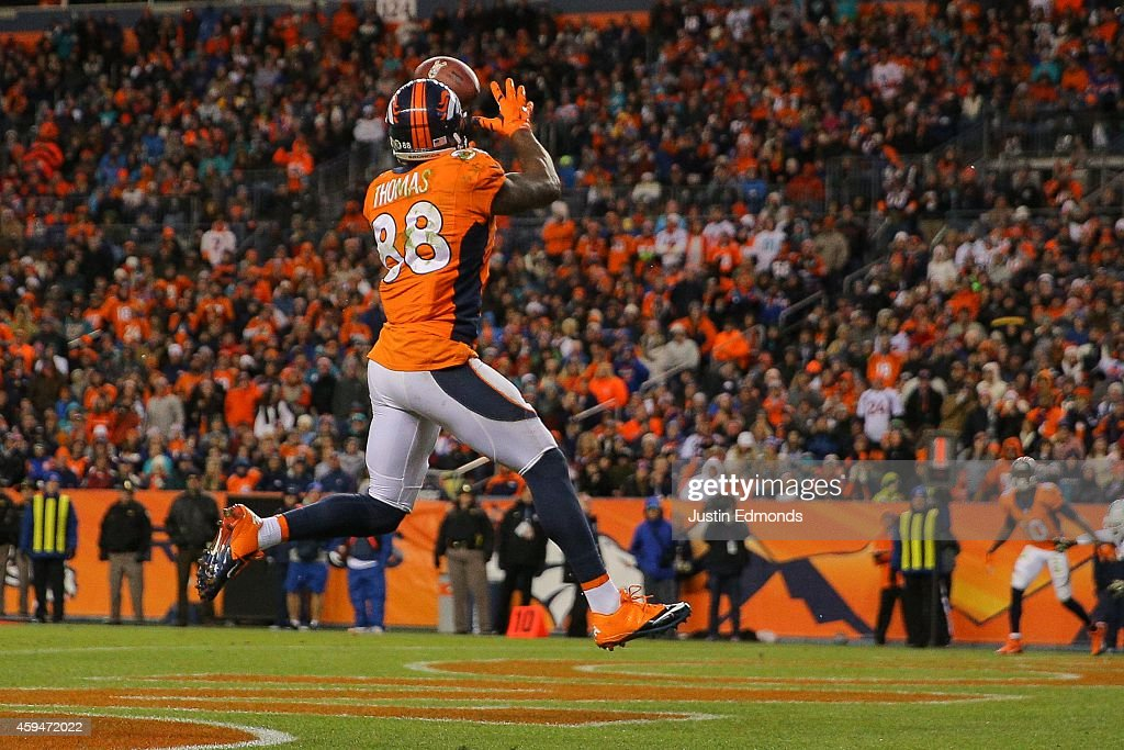 Wide receiver <a gi-track='captionPersonalityLinkClicked' href=/galleries/search?phrase=Demaryius+Thomas&family=editorial&specificpeople=4536795 ng-click='$event.stopPropagation()'>Demaryius Thomas</a> #88 of the Denver Broncos leaps to catch a 5-yard pass mid-stride in the end zone for a third quarter touchdown, his third of the night, against the Miami Dolphins during a game at Sports Authority Field at Mile High on November 23, 2014 in Denver, Colorado.