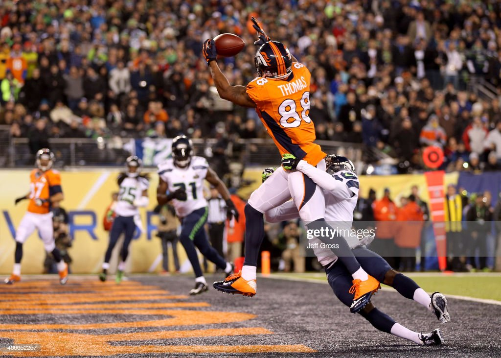 Wide receiver <a gi-track='captionPersonalityLinkClicked' href=/galleries/search?phrase=Demaryius+Thomas&family=editorial&specificpeople=4536795 ng-click='$event.stopPropagation()'>Demaryius Thomas</a> #88 of the Denver Broncos ran 14 yards to score a touchdown in the third quarter against cornerback Byron Maxwell #41 of the Seattle Seahawks during Super Bowl XLVIII at MetLife Stadium on February 2, 2014 in East Rutherford, New Jersey.