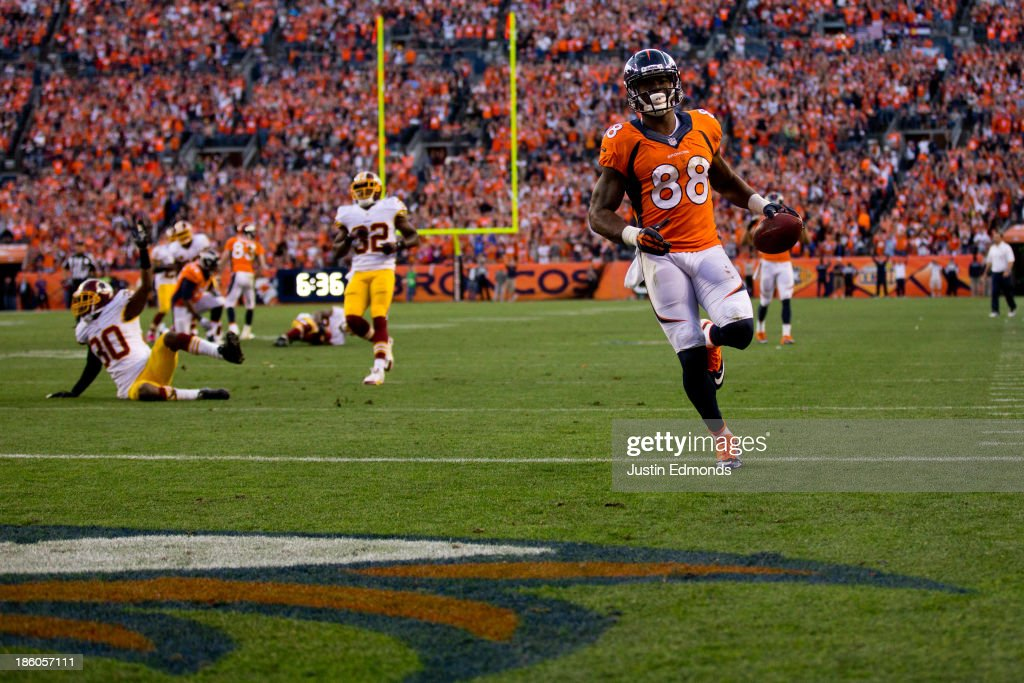 Wide receiver <a gi-track='captionPersonalityLinkClicked' href=/galleries/search?phrase=Demaryius+Thomas&family=editorial&specificpeople=4536795 ng-click='$event.stopPropagation()'>Demaryius Thomas</a> #88 of the Denver Broncos strides into the end zone for a 35-yard touchdown reception during the fourth quarter against the Washington Redskins at Sports Authority Field Field at Mile High on October 27, 2013 in Denver, Colorado. The Broncos defeated the Redskins 45-21.