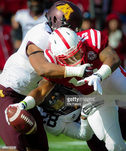 Wide receiver De'Mornay PiersonEl of the Nebraska Cornhuskers reaches the ball across the goal line in front of defensive back Damarius Travis of the...