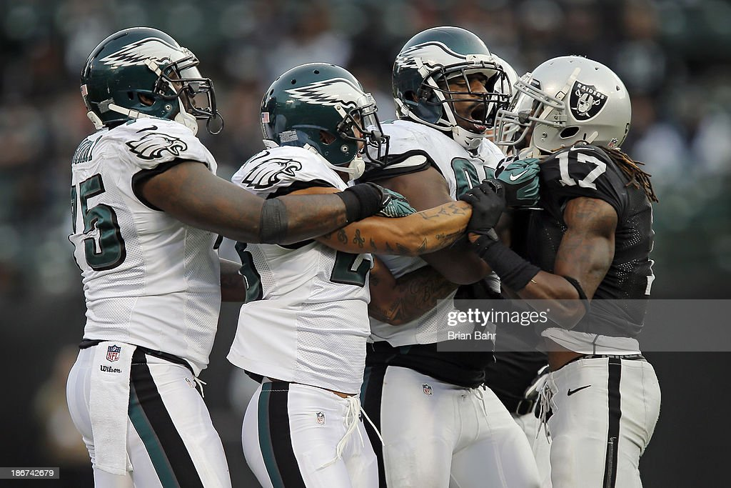 Wide receiver Denarius Moore #17 of the Oakland Raiders gets lectured by Vinny Curry #75, Patrick Chung #23, and Fletcher Cox #91 of the Philadelphia Eagles in the fourth quarter on November 3, 2013 at O.co Coliseum in Oakland, California. The Eagles won 49-20.