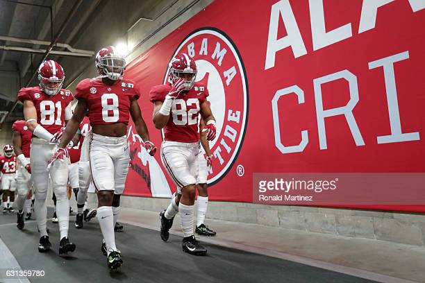 Wide receiver Derek Kief defensive back Jared Mayden and tight end Irv Smith Jr #82 of the Alabama Crimson Tide walk to the field prior to the 2017...