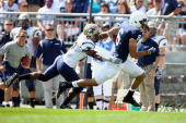 Wide receiver Derek Moye of the Penn State Nittany Lions runs after a catch against Wayne Cobham of the University of Akron Zips at Beaver Stadium on...