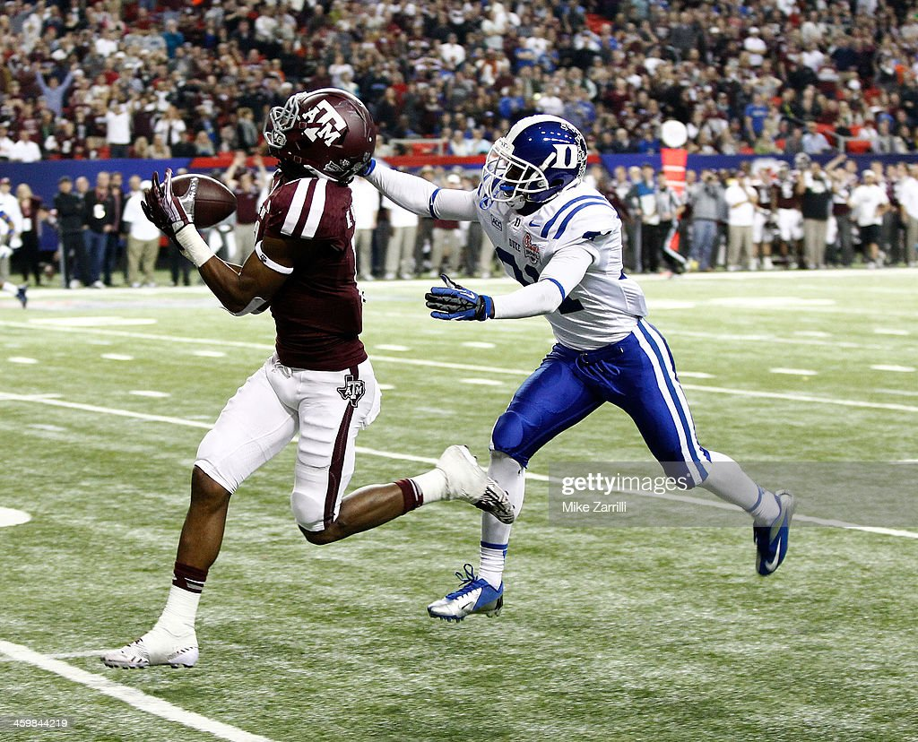 Wide receiver Derel Walker #11 of the Texas A&M Aggies runs for a touchdown on a pass reception in the fourth quarter against Breon Borders #31 of the Duke Blue Devils during the Chick-fil-A Bowl game at the Georgia Dome on December 31, 2013 in Atlanta, Georgia.