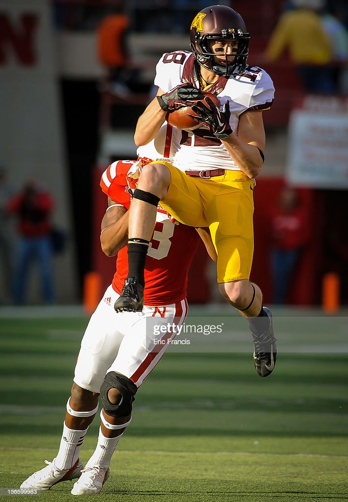 Wide receiver Derrick Engel #18 of the Minnesota Golden Gophers catches the ball in front of safety Daimion Stafford #3 of the Nebraska Cornhuskers during their game at Memorial Stadium on November 17, 2012 in Lincoln, Nebraska.