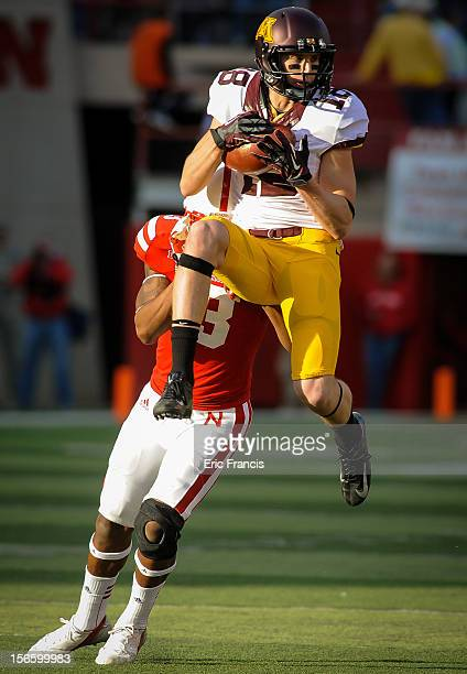 Wide receiver Derrick Engel of the Minnesota Golden Gophers catches the ball in front of safety Daimion Stafford of the Nebraska Cornhuskers during...