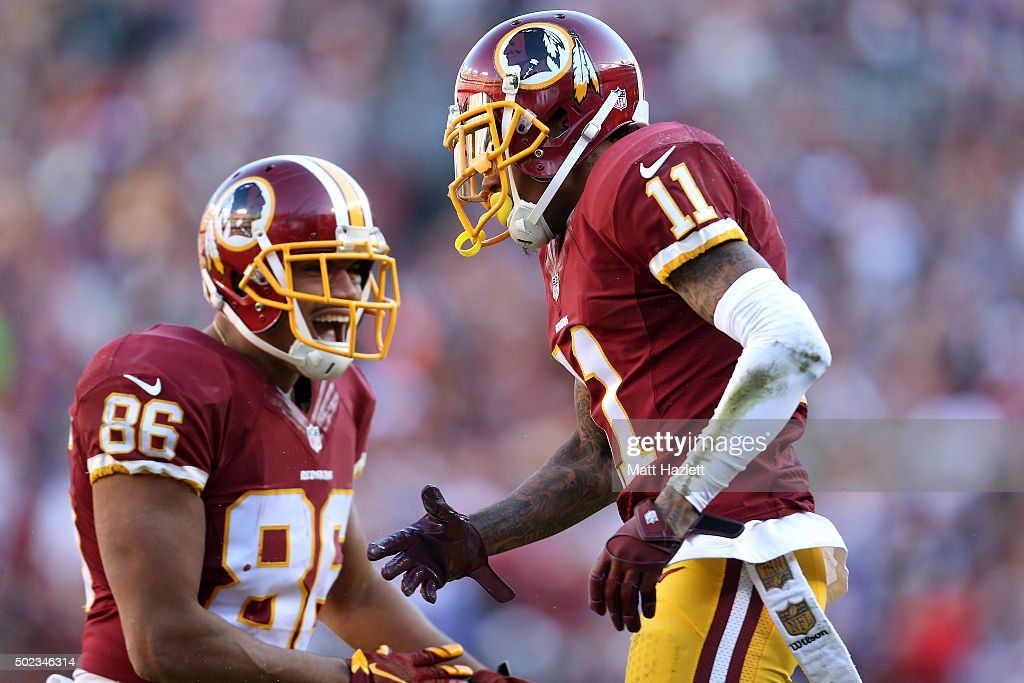 Wide receiver DeSean Jackson #11 and tight end Jordan Reed #86 of the Washington Redskins react to a play against the Buffalo Bills in the second quarter at FedExField on December 20, 2015 in Landover, Maryland.