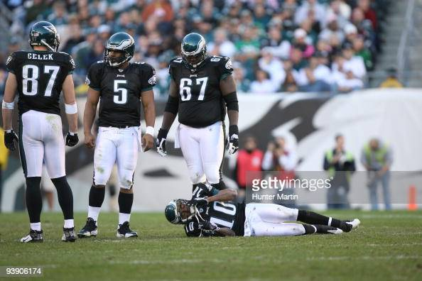 Wide receiver DeSean Jackson of the Philadelphia Eagles lies on the field after suffering a concussion as tight end Brent Celek quarterback Donovan...