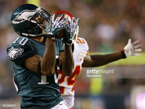 Wide receiver DeSean Jackson of the Philadelphia Eagles makes a 41 yard catch as cornerback Brandon Flowers of the Kansas City Chiefs defends during...