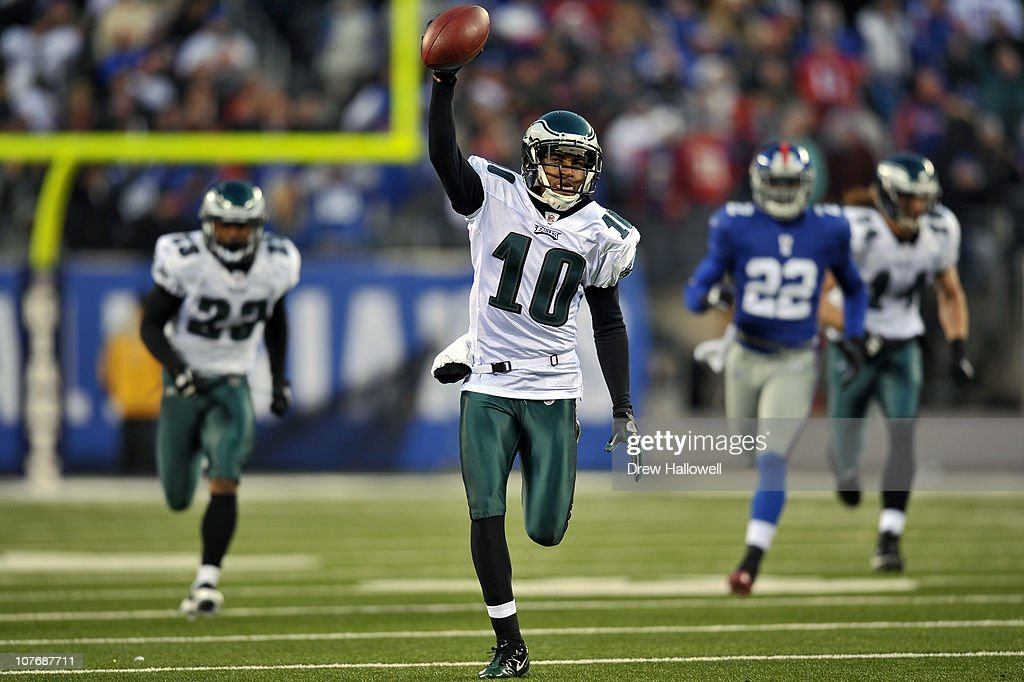 Wide Receiver <a gi-track='captionPersonalityLinkClicked' href=/galleries/search?phrase=DeSean+Jackson&family=editorial&specificpeople=2212775 ng-click='$event.stopPropagation()'>DeSean Jackson</a> #10 of the Philadelphia Eagles returns a punt for a touchdown and the victory in the final seconds of the game against the New York Giants at New Meadowlands Stadium on December 19, 2010 in East Rutherford, New Jersey. The Eagles won 38-31.
