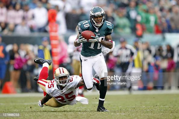 Wide receiver DeSean Jackson of the Philadelphia Eagles runs with the ball as cornerback Tarell Brown of the San Francisco 49ers attempts to make the...
