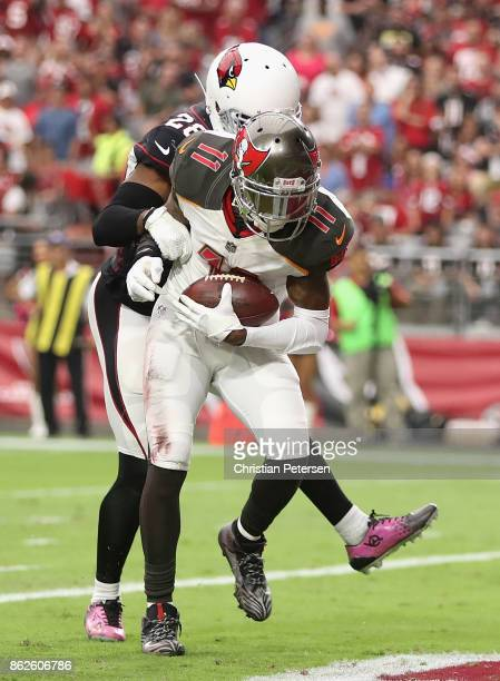 Wide receiver DeSean Jackson of the Tampa Bay Buccaneers catches a touchdown pass against cornerback Justin Bethel of the Arizona Cardinals during...