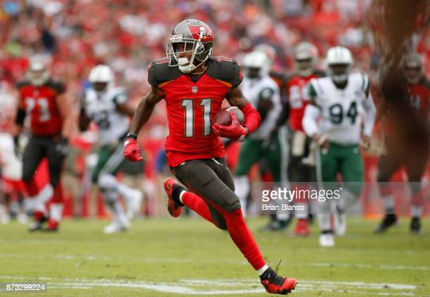 Wide receiver DeSean Jackson of the Tampa Bay Buccaneers runs for a first down during the first quarter of an NFL football game against the New York...