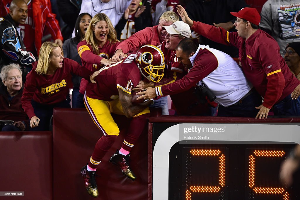 Wide receiver <a gi-track='captionPersonalityLinkClicked' href=/galleries/search?phrase=DeSean+Jackson&family=editorial&specificpeople=2212775 ng-click='$event.stopPropagation()'>DeSean Jackson</a> #11 of the Washington Redskins celebrates with fans following his second quarter touchdown against the Seattle Seahawks at FedExField on October 6, 2014 in Landover, Maryland.