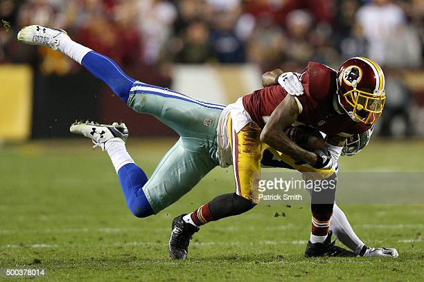 Wide receiver DeSean Jackson of the Washington Redskins is tackled by cornerback Brandon Carr of the Dallas Cowboys in the third quarter at...