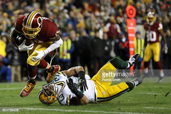Wide receiver DeSean Jackson of the Washington Redskins scores a first quarter touchdown past strong safety Micah Hyde of the Green Bay Packers at...
