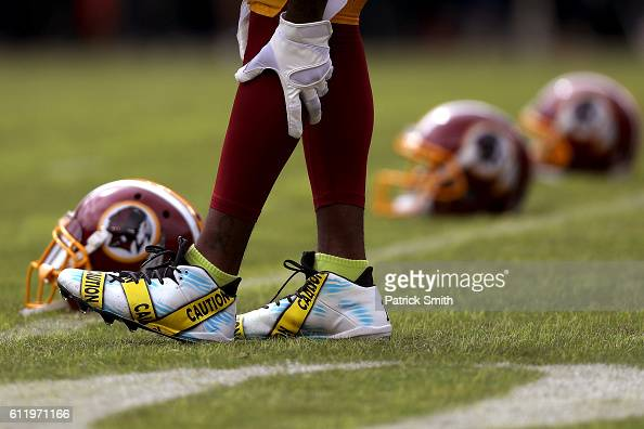 Wide receiver DeSean Jackson of the Washington Redskins wears cleats displaying police caution tape prior to a game against the Cleveland Browns at...
