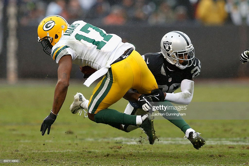 Wide Receiver Devante Adams #17 of the Green Bay Packers is tackled by Corner Back David Amerson #29 of the Oakland Raiders in the second quarter at O.co Coliseum on December 20, 2015 in Oakland, California.