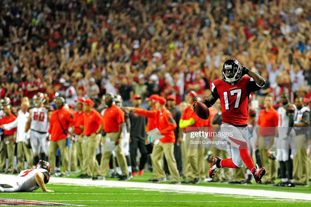 Wide receiver Devin Hester of the Atlanta Falcons returns a punt for a touchdown against the Tampa Bay Buccaneers during a game at the Georgia Dome...