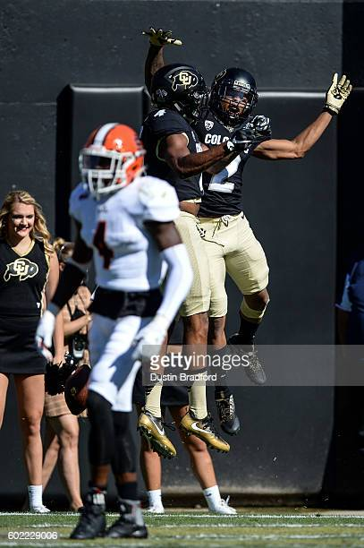 Wide receiver Devin Ross of the Colorado Buffaloes celebrates with wide receiver Bryce Bobo after Ross caught a first quarter touchdown against the...
