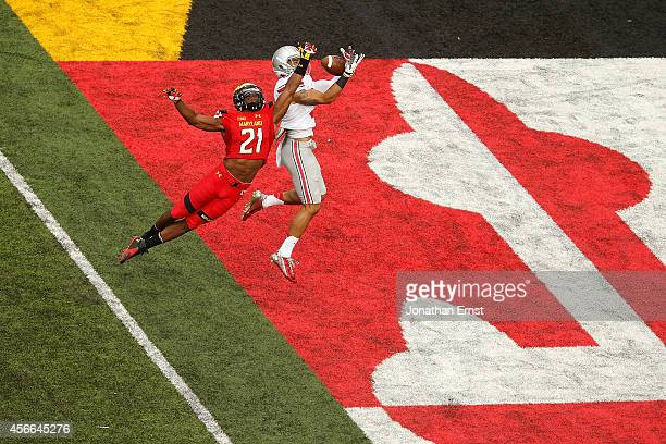 Wide receiver Devin Smith of the Ohio State Buckeyes catches a touchdown pass against safety Sean Davis of the Maryland Terrapins in the third...